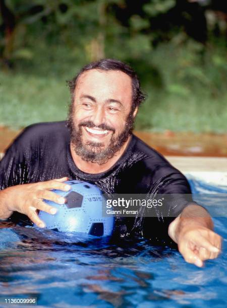 Portrait of Italian tenor Luciano Pavarotti as he swims at his home, Pesaro, Italy, 1993.