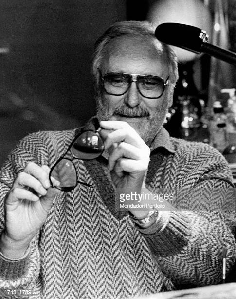 Portrait of Italian writer and lyric-writer Antonio Amurri with some ornaments in front of him. 1980s.
