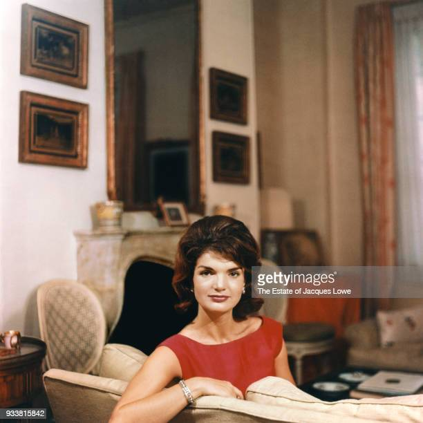 Portrait of Jacqueline Kennedy as she looks over the back of a couch late 1950s or early 1960s