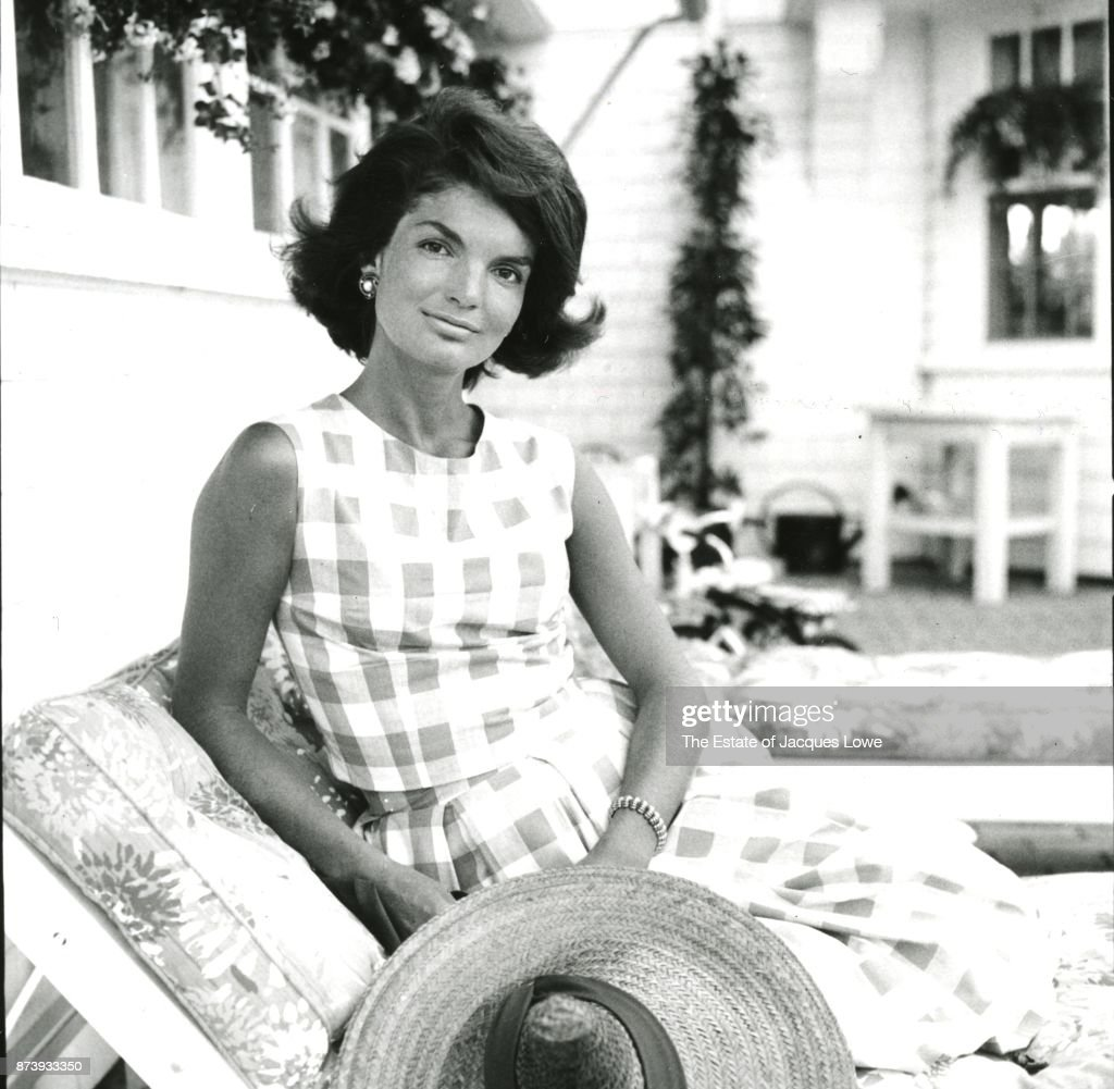 Portrait of (future US First Lady) Jacqueline Kennedy (nee Bouvier, 1929 - 1994) as she poses on a porch, Hyannis Port, Massachusetts, Summer 1960.