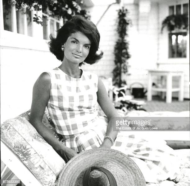 Portrait of Jacqueline Kennedy as she poses on a porch Hyannis Port Massachusetts Summer 1960