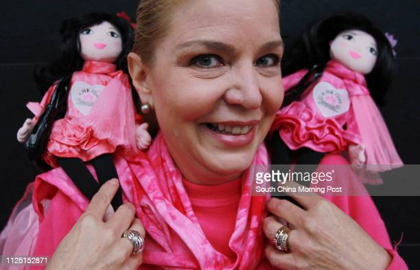 Portrait of Jacqueline Nielson posing with her A HK Girl dolls 15FEB11