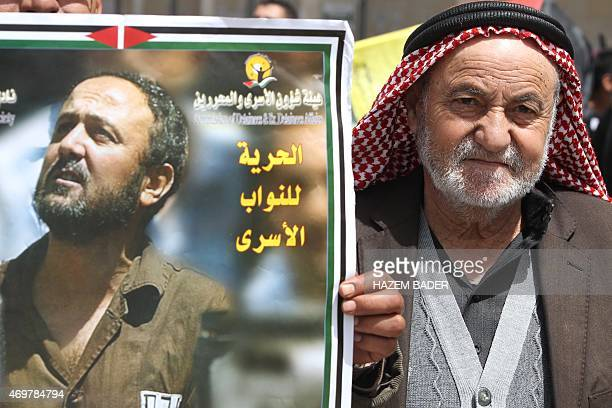 A portrait of jailed Palestinian Fatah leader Marwan Barghuti is seen as families of Palestinians held in Israeli prisons protest in the West Bank...
