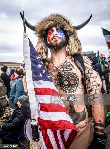 """Portrait of Jake Angeli, a QAnon supporter known for his painted face and horned hat outside the US Capitol following a """"Stop the Steal""""..."""