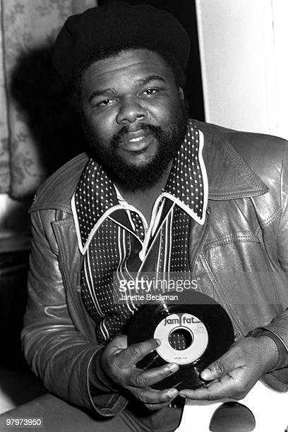Portrait of Jamaicanborn British reggae producer Fatman London England 1979 He holds a copy of a seven inch single 'Mr Brown' by U Black on the label...