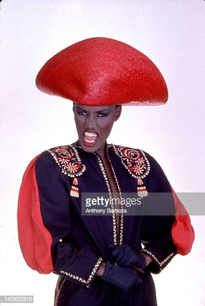 Portrait of Jamaicanborn model singer and actress Grace Jones as she wears a bright red hat and multicolored top New York New York late twentieth...