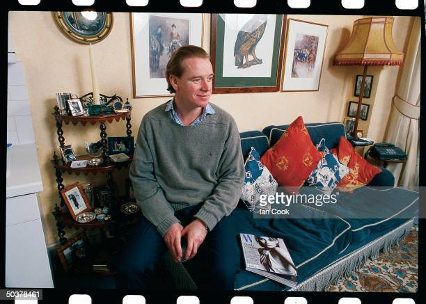 Portrait of James Hewitt excavalry officer former lover of England's Princess Diana posing in his apt