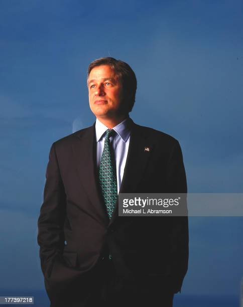 Portrait of Jamie Dimon against blue background undated