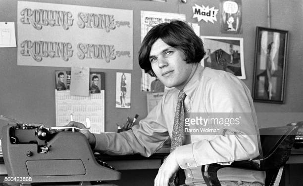 Portrait of Jann Wenner, founder and publisher of Rolling Stone magazine, sitting at a typewriter in the magazine's original offices on Brannan St in...