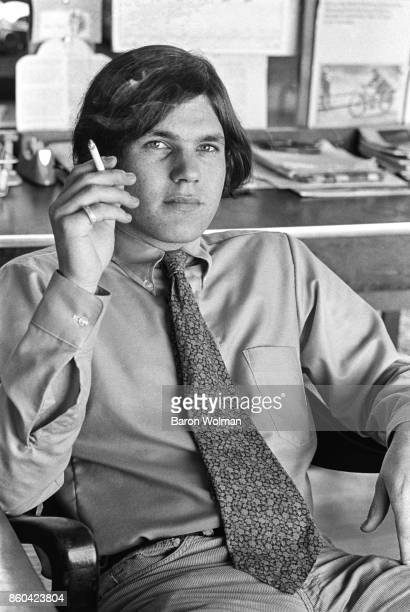 Portrait of Jann Wenner, founder and publisher of Rolling Stone magazine, smoking, in the magazine's original offices on Brannan St in San Francisco,...