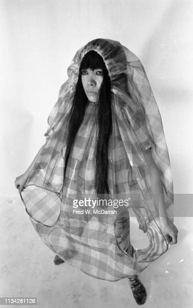 Portrait of Japanese artist Yayoi Kusama as she poses in a plaid outfit of her own design at a 'nude fashion' event New York New York July 30 1969