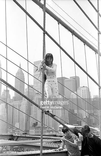 Portrait of Japanese artist Yayoi Kusama as she poses on the Brooklyn Bridge dressed in polka dots New York New York May 17 1968