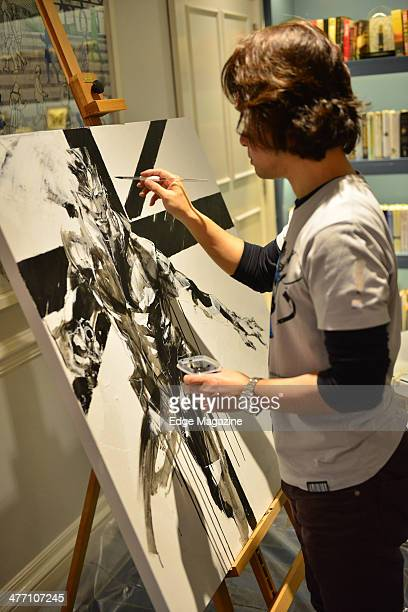 Portrait of Japanese artist Yoji Shinkawa painting in London on February 22 2013 Shinkawa is best known as the conceptual designer for much of the...