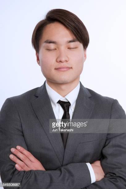 portrait of japanese business man - 目を閉じた ストックフォトと画像