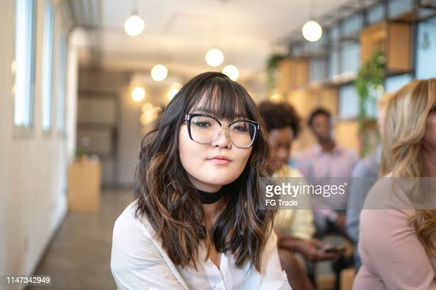portrait of japanese businesswoman at business conference - event - participant stock pictures, royalty-free photos & images