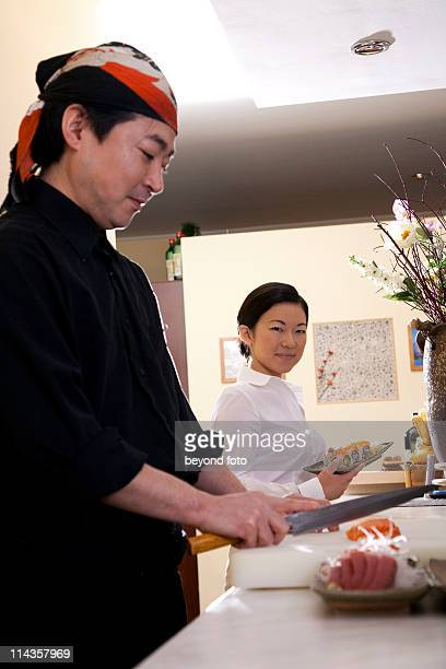 portrait of japanese chef preparing sushi