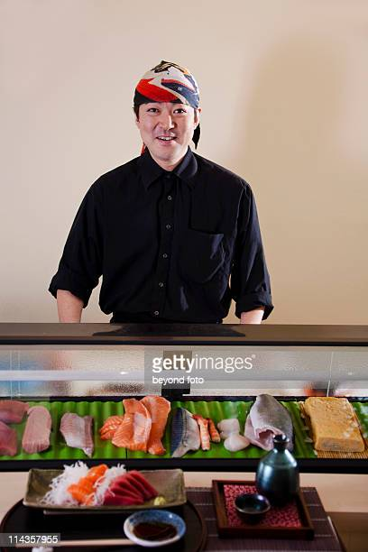 portrait of japanese chef presenting sushi in restaurant