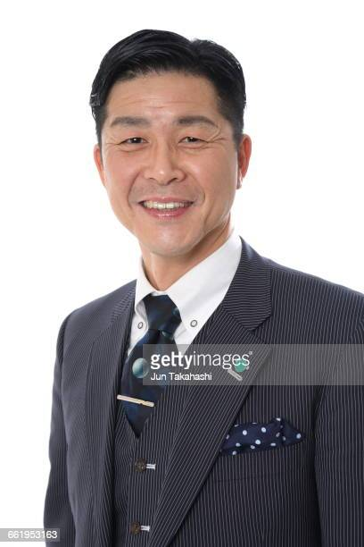 portrait of japanese man - striped suit stock photos and pictures