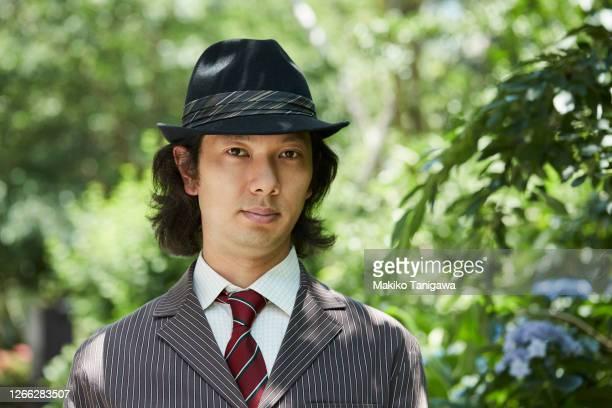 portrait of japanese man wearing hat - 男らしさ ストックフォトと画像