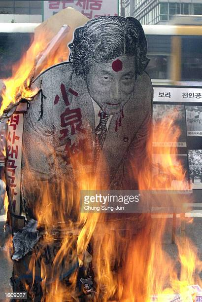 A portrait of Japanese Prime Minister Junichiro Koizumi burns during an antiJapan rally August 14 2001 at Togol Park in Seoul South Korea...