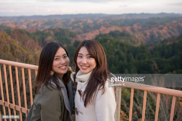 portrait of japanese sisters at observatory - sister stock pictures, royalty-free photos & images
