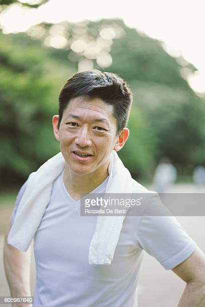 Portrait Of Japanese Sport Man Outdoors In The Early Morning
