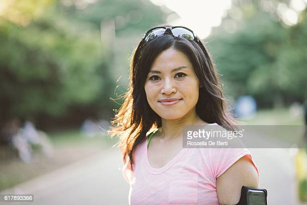 Portrait Of Japanese Sport Woman Outdoors In The Early Morning