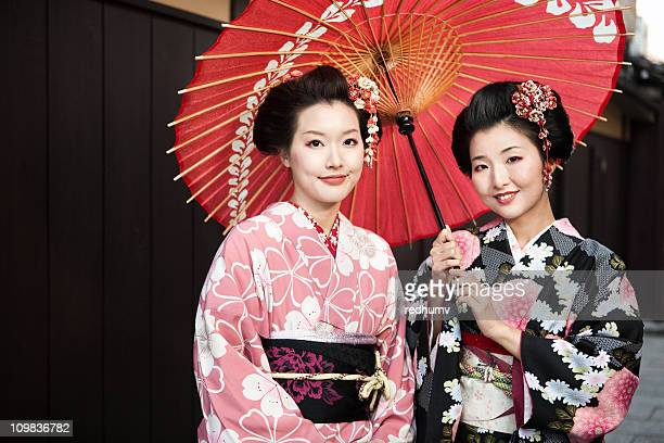 Portrait of Japanese women in traditional dress with parasol