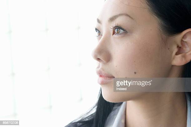 Portrait of Japanese young woman, side view