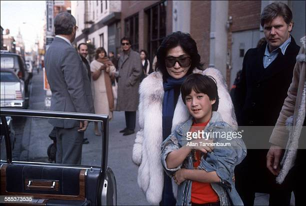 Portrait of Japaneseborn artist and musician Yoko Ono and her son future musician Sean Lennon as they leave a restaurant on West Broadway New York...
