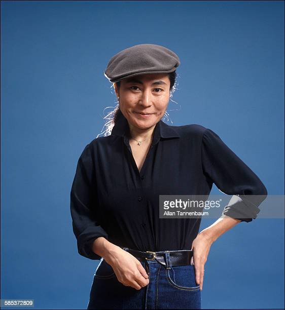 Portrait of Japaneseborn artist and musician Yoko Ono as she poses against a blue background New York New York November 20 1980 The photo was taken...