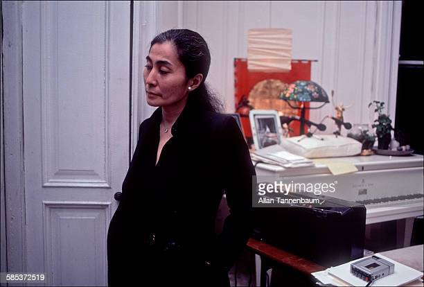 Portrait of Japaneseborn artist and musician Yoko Ono as she stands in the music room of her home at the Dakota Apartments New York New York February...