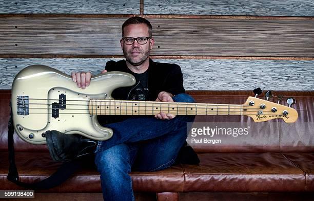 Portrait of jazz bass player Josh Haden holding an Antigua finish Fender Precision bass guitar Arnhem Netherlands 22nd May 2016