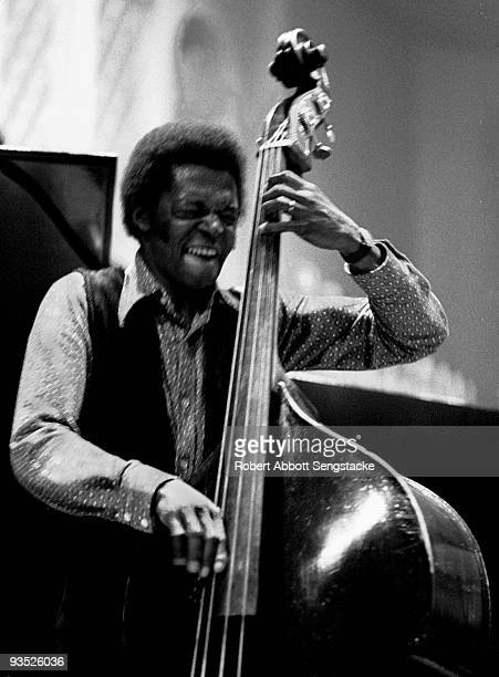 Portrait of jazz bassist Jimmy Garrison performing with Alice Coltrane during a concert at Fisk University Nashville TN 1971