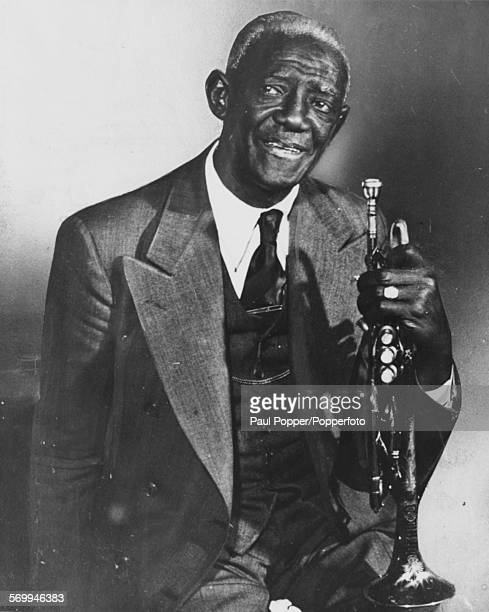 Portrait of jazz musician Willie 'Bunk' Johnson holding his trumpet, circa 1940.