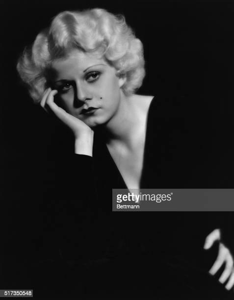 Portrait of Jean Harlow in a pensive pose wearing a black vnecked dress Undated photograph