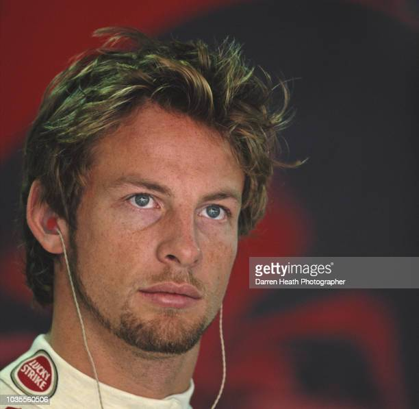 A portrait of Jenson Button of Great Britain driver of the Lucky Strike BAR Honda BAR 007 Honda RA005E V10 during practice for the Formula One...