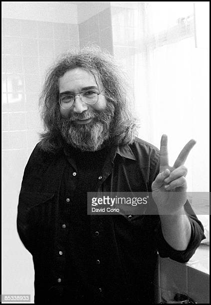 Portrait of Jerry Garcia of the Grateful Dead doing a peace sign gesture London 22nd March 1981