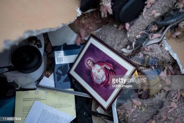 A portrait of Jesus is seen among rubble caused by a tornado that sturck the area the night before At least 1 person is dead and 12 injured from the...
