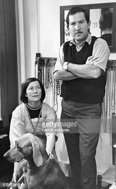 Portrait of jewelery designer Mary Rattray Kanovitz with her dog and husband artist Howard Kanovitz in her shop Queen of Diamonds November 1 1964