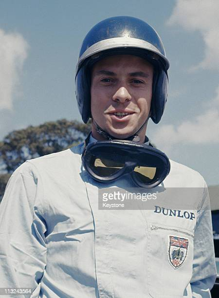 A portrait of Jim Clark driver of the Aston Martin DB4 GT Zagato before the start of the World Sportscar Championship Tourist Trophy on 18th August...