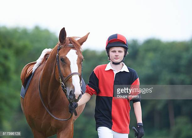 portrait of jockey with race horse. - jockey stock pictures, royalty-free photos & images