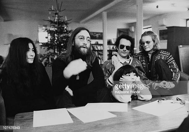 Portrait Of John Lennon And Yoko Ono With Daughter Kyoko And With Anthony Cox During A Press Conference In Denmark During Seventies