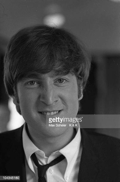 Portrait of John Lennon during the making of the Beatles film 'A Hard Day's Night' in March 1964 on a train in southern England