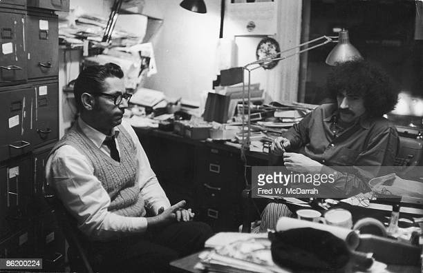Portrait of journalists Louis Salzberg and Howard Smith in the cluttered offices of the Village Voice New York New York late 1960s
