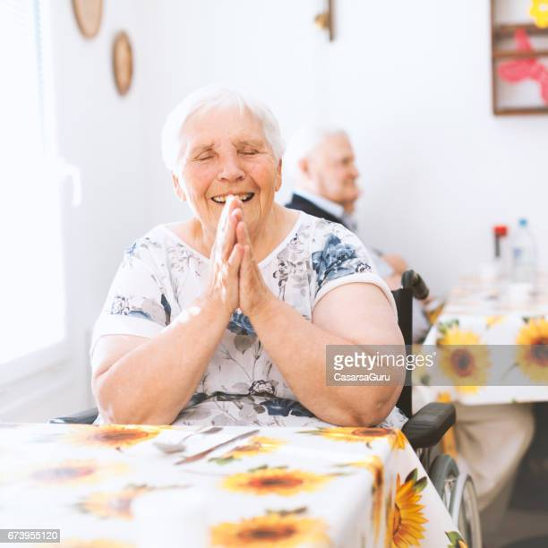 portrait of joyful senior woman in the nursing home - residential care stock photos and pictures