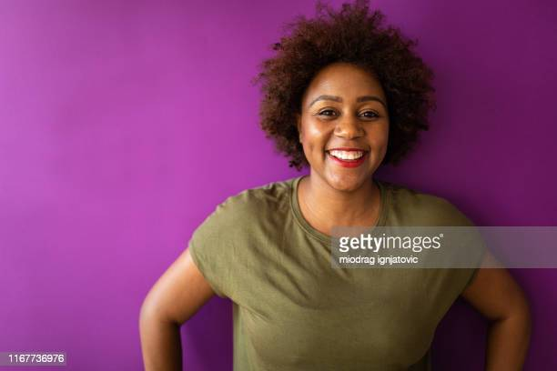 portrait of joyful young woman with afro hair - purple stock pictures, royalty-free photos & images