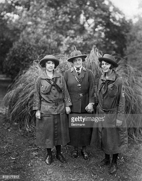 Portrait of Juliette Gordon Low founder of the Girl Scouts of the USA with two girl scouts in the early years of the movement Undated photograph