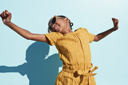 Portrait of jumping cool girl with sunglasses - gettyimageskorea
