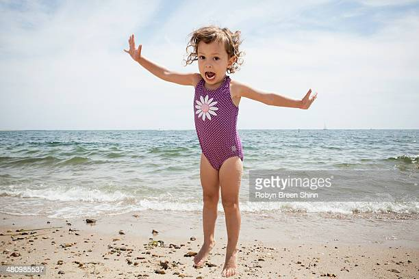 Portrait of jumping female toddler on beach at Falmouth, Massachusetts, USA